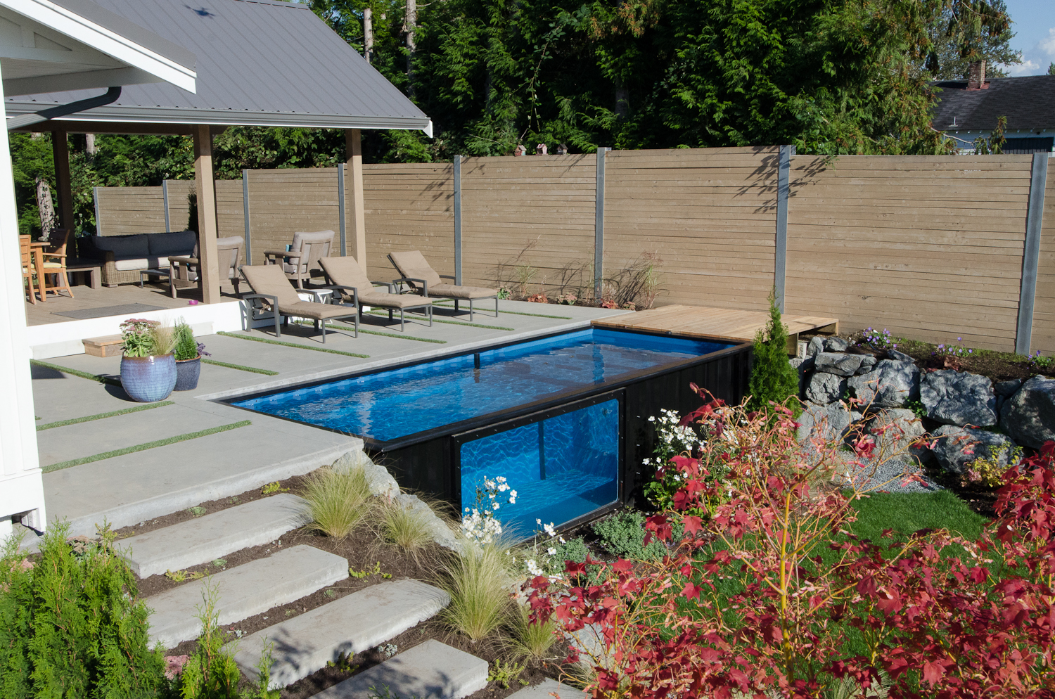 Swimming pool garden  Shipping Containers Transform Into Garden Swimming Pools - DesignCurial